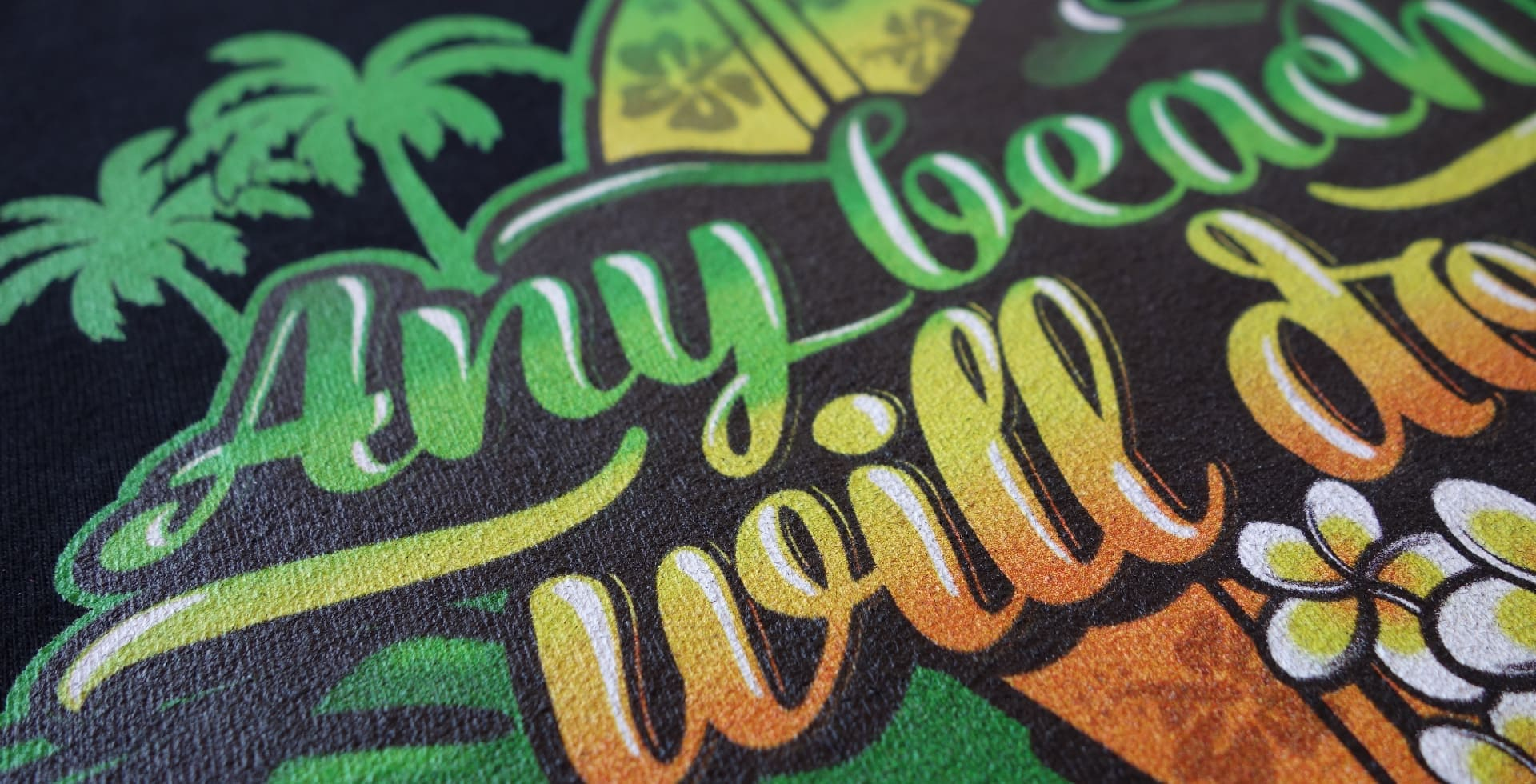 Section of a beach design print on a black t-shirt